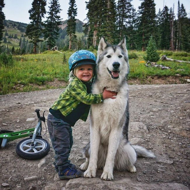 Kid posing with a dog